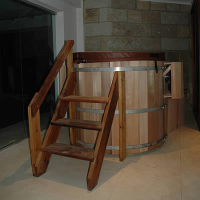 Ukko Original Western Red Cedar Hot tub with stairs, shelving, skirting and equipment enclosure