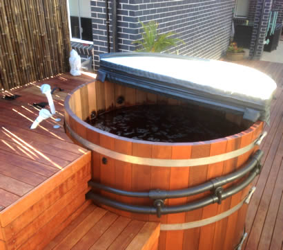 Hot tub with deck enclosure and stairs