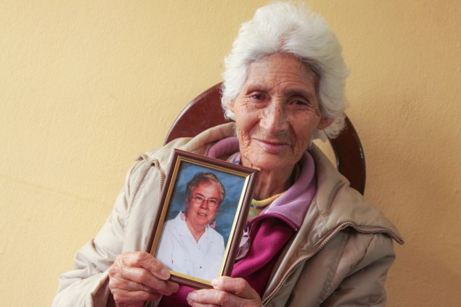 Miss Antonia holds up her prized possession — a photo of her sponsor, Robby Stozier.