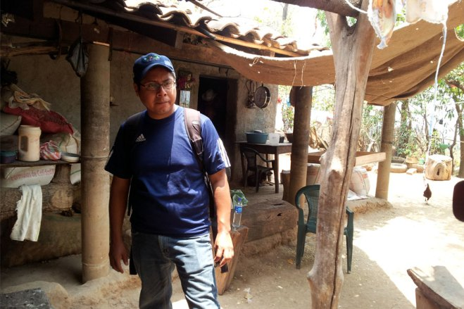 Luis Cocon visits a home in El Salvador.