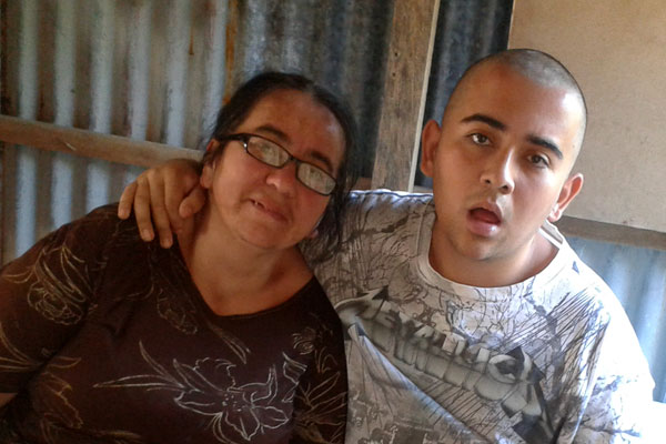 Marjorie with her son Ulises at their home in Costa Rica.