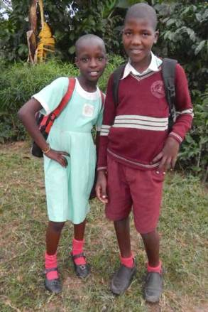 From left: Unbound sponsored children Hanisha and Michael in Uganda.