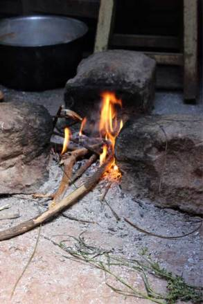 Lucy built her cooking fire between three stones so she could easily balance the pot over the fire.