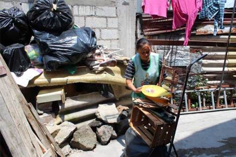 Maria finds discarded items that can be fixed and resold to support her family.