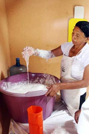 Amparo mixes the shampoo ingredients by hand.
