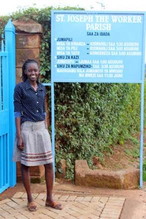 Jacinta Wanjiku, Unbound staff member in Nairobi, stands outside the church where the papal Mass will take place.