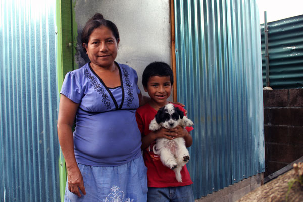 From left: Rosa, Hector and their puppy.