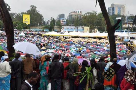 Kenyans stand in the rain to hear Pope Francis at the University of Nairobi.