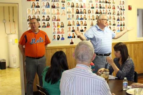 Larry Livingston (right) introduces Father Mike Rieder to members of the Unbound staff in Kansas City, KS.