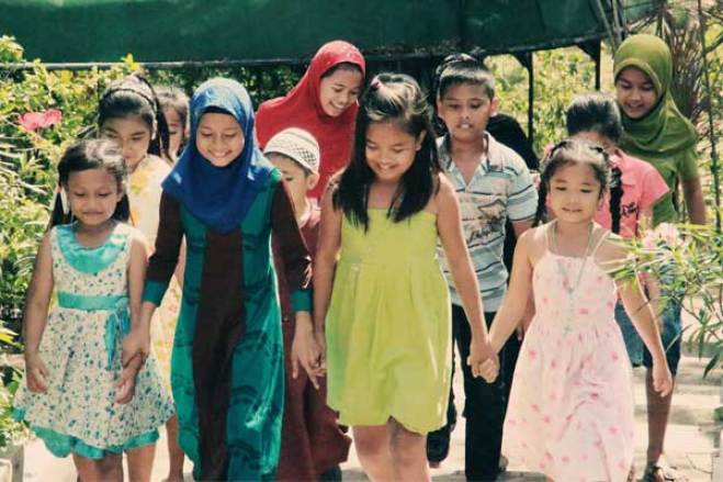 Sponsored children in the southern Philippines play together. Unbound promotes peace and harmony in the region through activities with children and families.