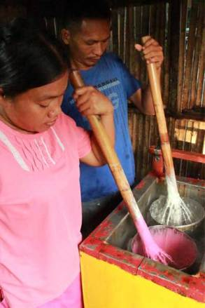 Judith (left) and Reynald (right) make their morning batch of ice cream — strawberry and mango!