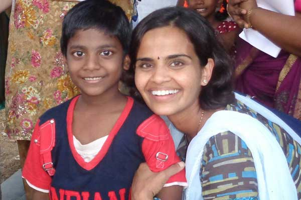 In her role as program director at Unbound, Pritha visits sponsored child Antony at Antony's home in India.