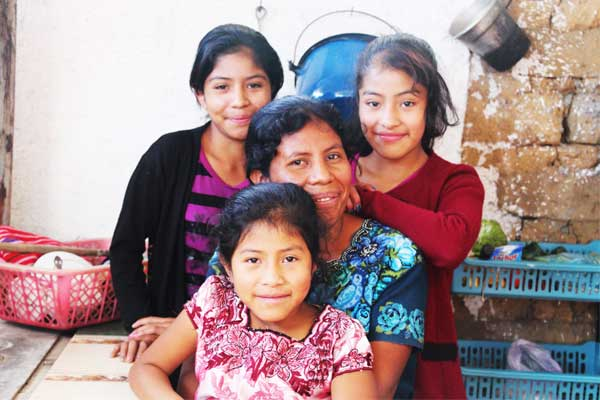 Gilberta (front), her mother, Cristina (center), and sisters Nicolasa (left) and Juana are a close-knit family.