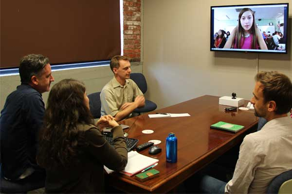 During a Skype call with Unbound staff members Andrew Kling, Joe Sundermeyer, Melissa Velazquez and Barclay Martin, G.W. Carver Elementary School sixth-grader Anahy asks questions on behalf of her class.
