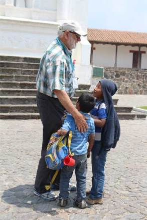 Sponsor Jesse Fabian is greeted by children sponsored through Unbound on a visit to Guatemala.