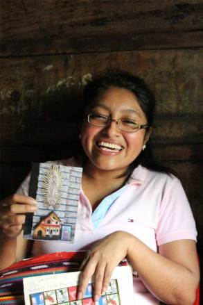 Gabriela shows some of the letters of encouragement she has received from her sponsor, Bruno in Canada.