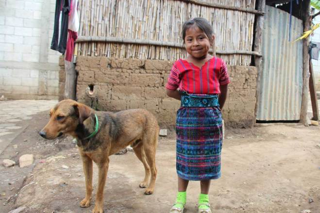 Cat or dog? Sponsored child Keily from Guatemala chooses both!