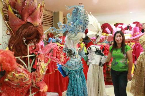 Image = Jeanalyn displays her creations on stands and mannequins when they are not being worn by performers.
