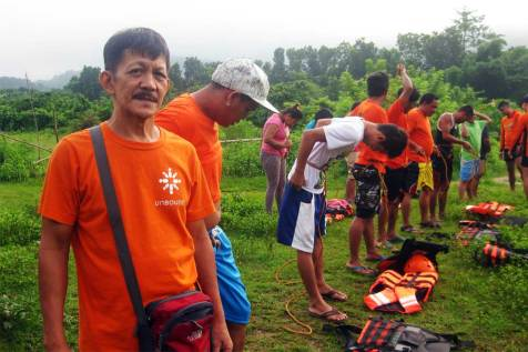 An image of fathers in the Philippines taking a course in water rescue.