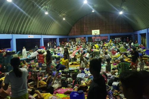 Families in Marikina City, served by our Manila program, seek refuge in a local storm shelter along with others from their community.