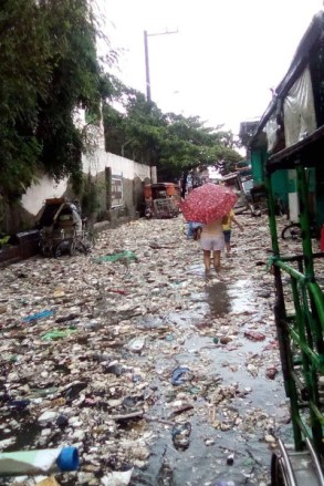 A street in the Novatas area of Quezon City, Philippines, after floodwaters receded.