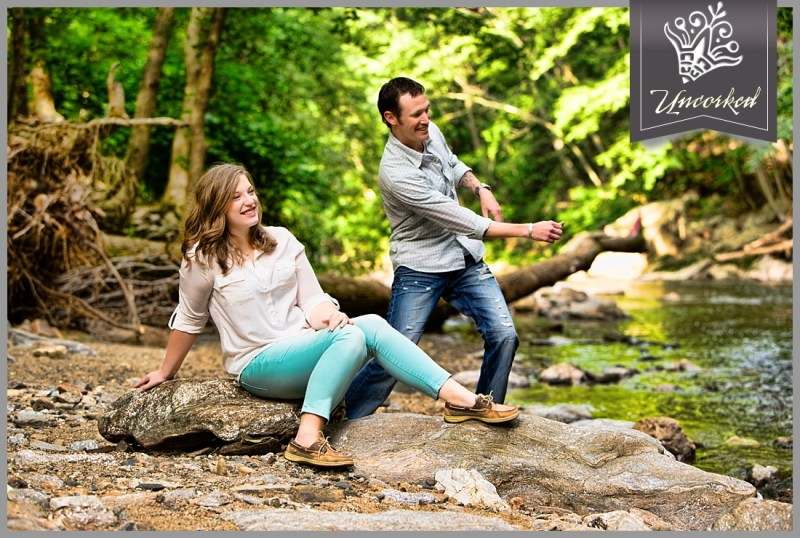 Skipping rocks at their engagement session at Forbidden Drive, Philadelphia PA - © 2013 Uncorked Studios, LLC - Destination & Philadelphia Pennsylvania Wedding Photographer