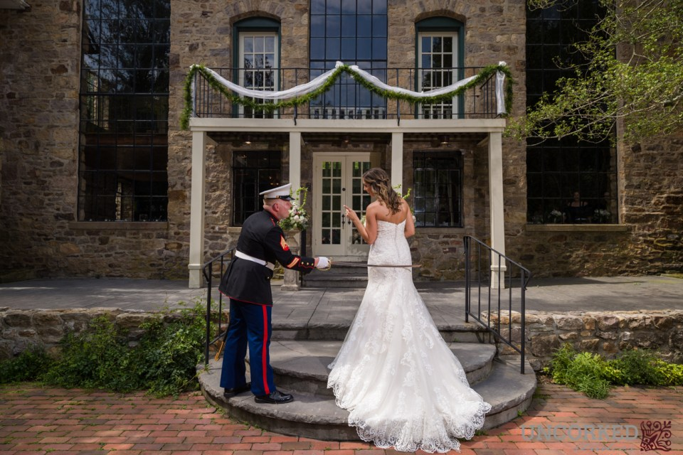 Military sword swat to the blushing bride