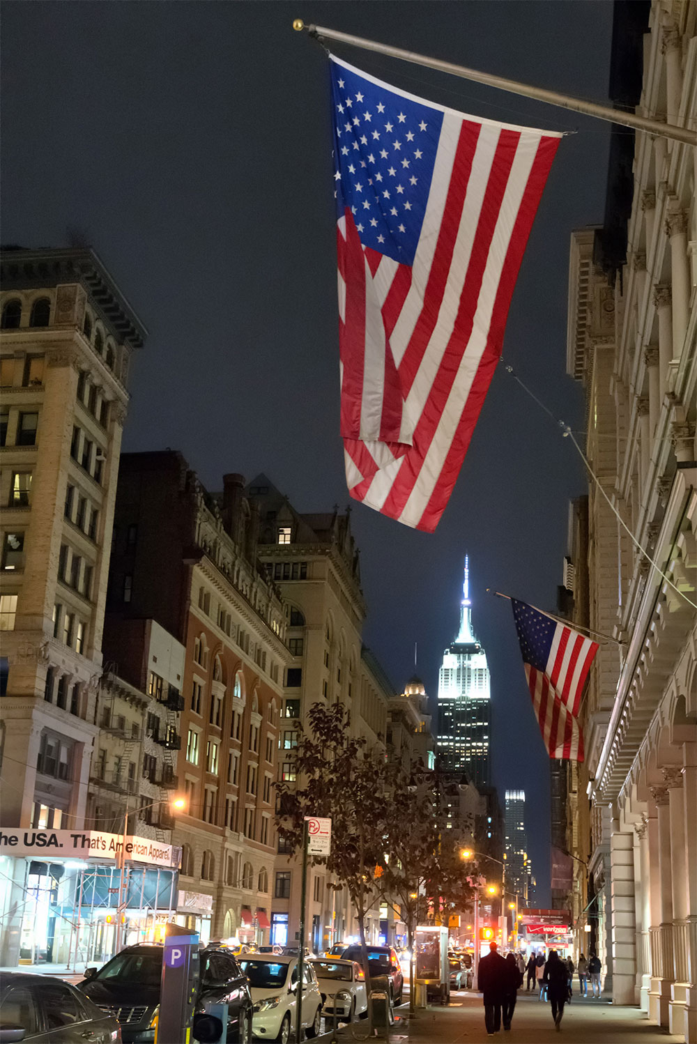USA Flag in New York City with beautiful Empire State Building
