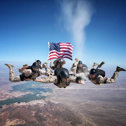 "Air Force Staff Sgt. Johnny Gunn. Gunn took this photo of Marine free fall instructors spreading the ashes of Sgt. Brett Jaffe over the Phillips Drop Zone at Yuma Proving Grounds, Ariz., in keeping with his final request. ""This was a memorial ash release dive, by Marines, for a Marine, at the request of a Marine wife,"" Gunn said. ""I ... was honored to be asked to do this. It gave me goose bumps taking it, and still does every time I see it!"""