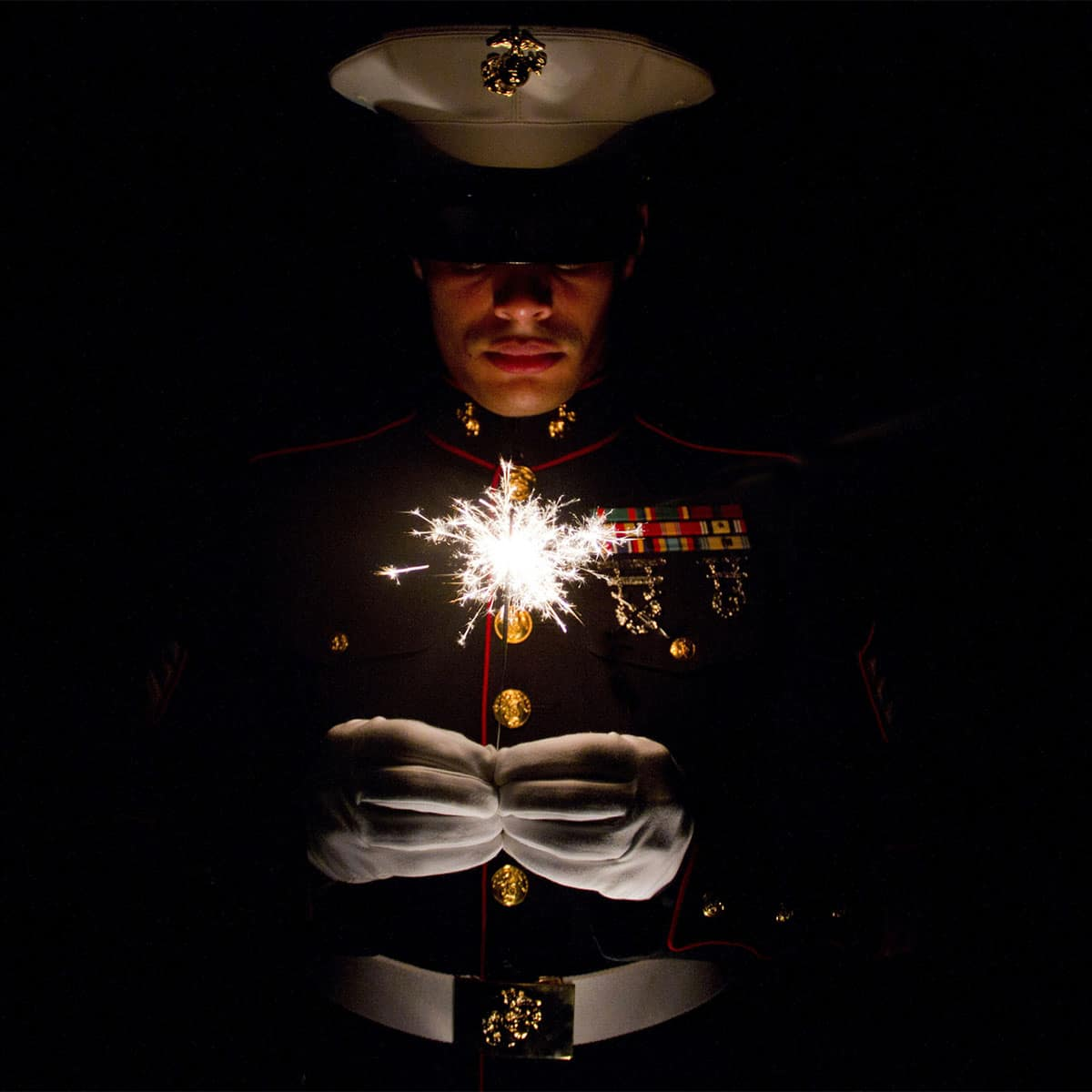 Sgt. Geovanni Cruz, 28, from New Britain, Conn., celebrates Independence Day July 4, 2016. Cruz is a motor transportation mechanic with Marine Wing Support Squadron 471.