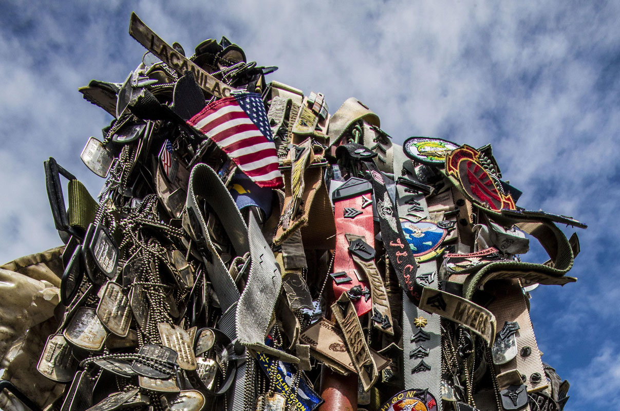 IWO TO, Japan - Personal mementos are left to symbolize the respect generations of service members have paid during their visit to the summit of Mount Suribachi, Iwo Jima, Japan, March 25, 2017. Suribachi is where five Marines and a Navy Corpsman famously raised the American flag, signaling the successful seizure of the northern end of the island.