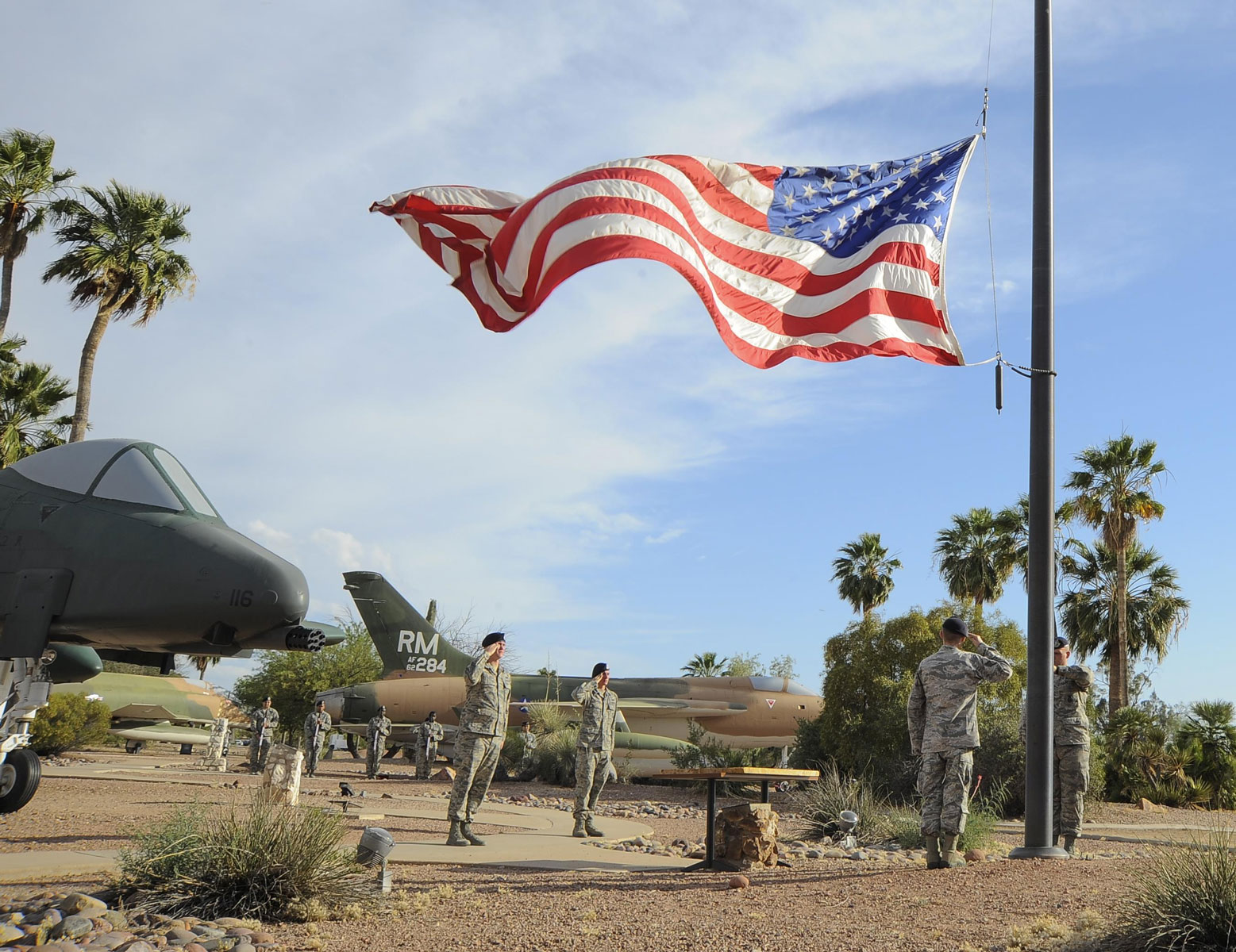 Airmen from the 355th Security Forces Squadron lower the American flag during a retreat ceremony for National Police Week at Davis-Monthan Air Force Base, Arizona, May 14. The retreat ceremony honored security forces and law enforcement members who have died in the line of duty.