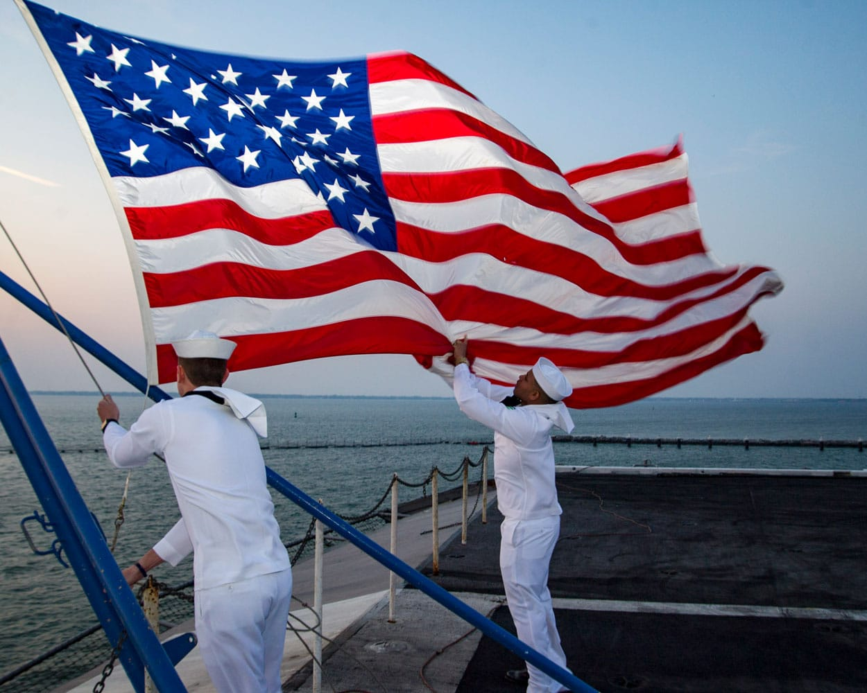 b41ea621f867 U.S. Navy Sailors assigned to the color guard aboard the aircraft carrier  USS Dwight D.