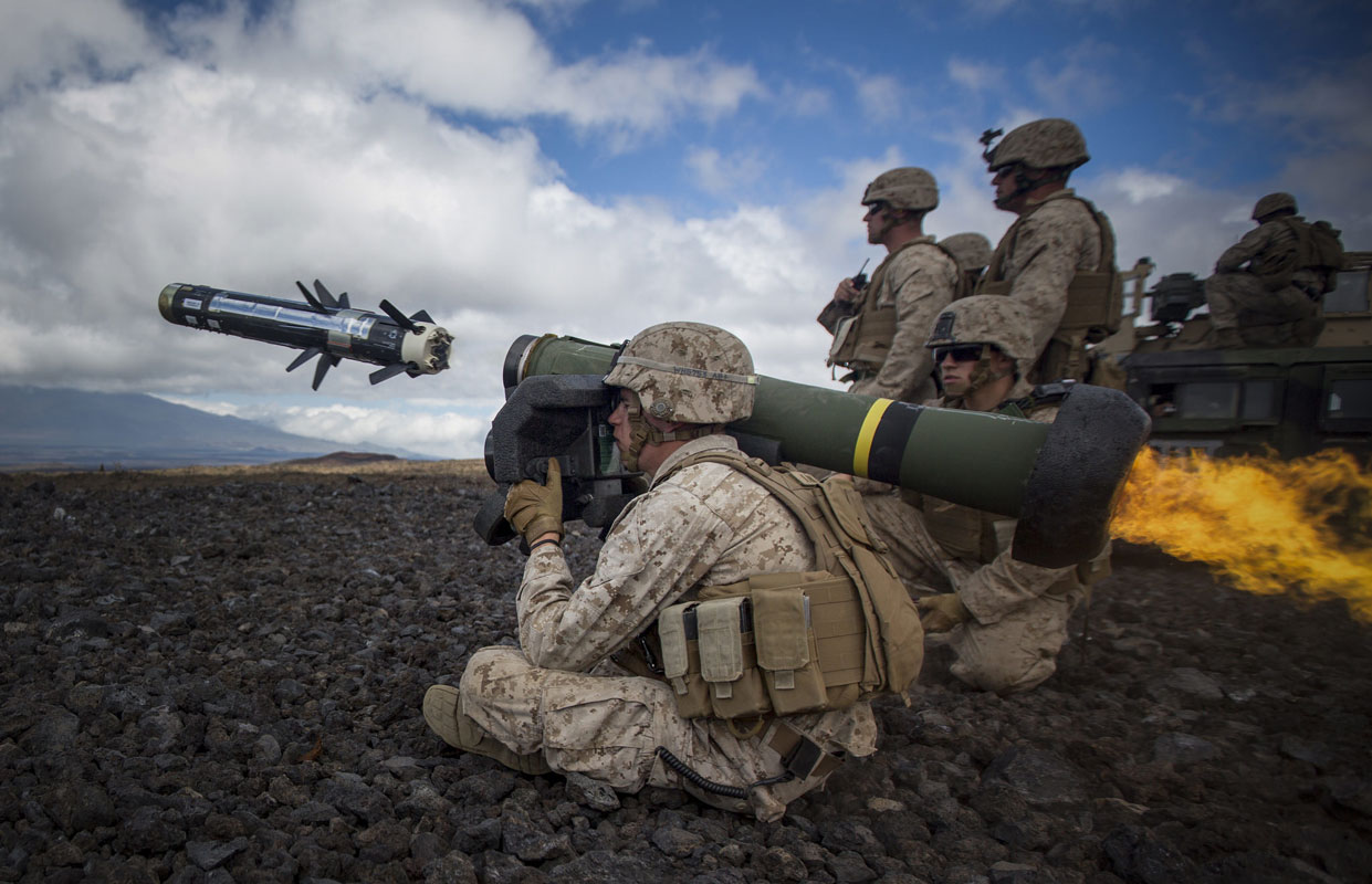 "A U.S. Marine attached to Weapons Company, 1st Battalion, 3rd Marine Regiment - ""The Lava Dogs"" fires a Javelin at an enemy tank during Lava Viper aboard Pohakuloa Training Area, Hawaii."