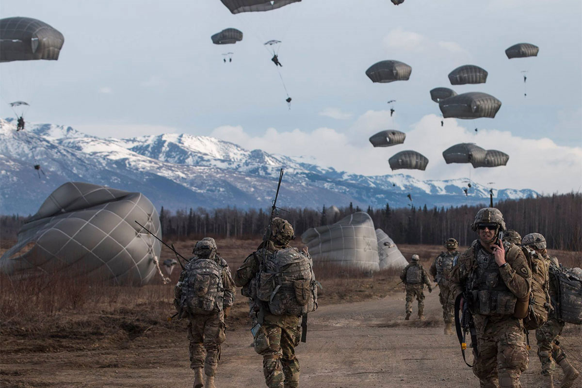 501st Parachute Paratroopers Infantry Regiment leaders observe as their follow-on paratroopers exit a U.S. Air Force C-17 Globemaster to join in the fight during a Joint Forcible Entry Operation exercise at Joint Base Elmendorf-Richardson, Alaska. Hundreds of paratroopers jumped from U.S. and Royal Canadian Air Force aircraft in conjunction with the biennial U.S. Air Force Alaska Command exercise Northern Edge. It is in preparation for upcoming training at the Joint Readiness Training Center in Fort Polk, La.