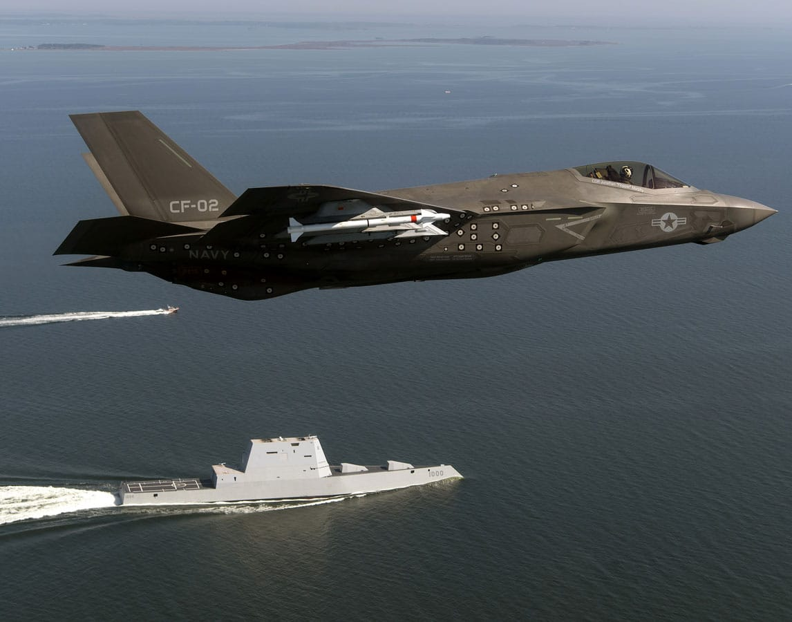 Aircraft CF-02, an F-35 Lightning II Carrier Variant attached to the F-35 Pax River Integrated Test Force (ITF) assigned to Air Test and Evaluation Squadron (VX) 23 completes a flyover of the guided-missile destroyer USS Zumwalt