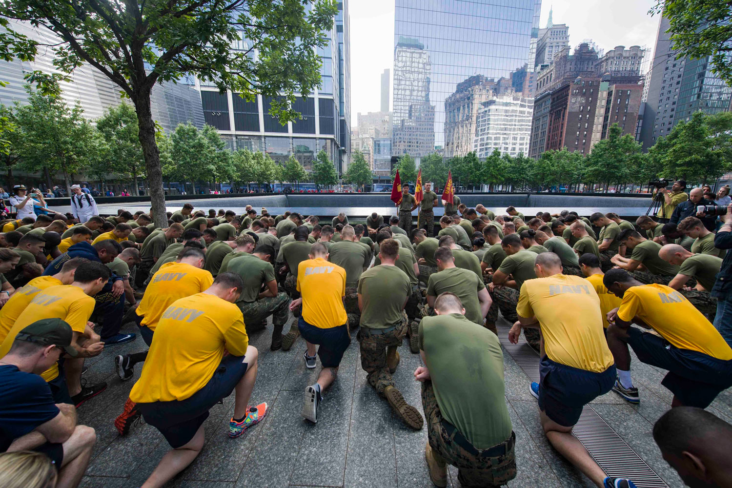 Marines and Sailors kneel during a moment of silence at the National September 11 Memorial & Museum following the second annual Freedom Run in downtown Manhattan for 2017 Fleet Week New York. Fleet Week New York, now in its 29th year, is the city's time honored celebration of the sea services. It is an unparalleled opportunity for the citizens of New York and the surrounding tri-state area to meet Sailors, Marines and Coast Guardsmen, as well as witness firsthand the latest capabilities of today's maritime services.