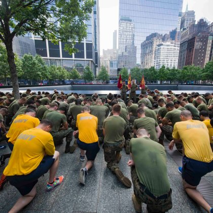 Marines and Sailors kneel during a moment of silence at the National September 11 Memorial & Museum following the second annual Freedom Run in downtown Manhattan for 2017 Fleet Week New York. Fleet Week New York, now in is 29th year, is the city's time honored celebration of the sea services. It is an unparalleled opportunity for the citizens of New York and the surrounding tri-state area to meet Sailors, Marines and Coast Guardsmen, as well as witness firsthand the latest capabilities of today's maritime services.
