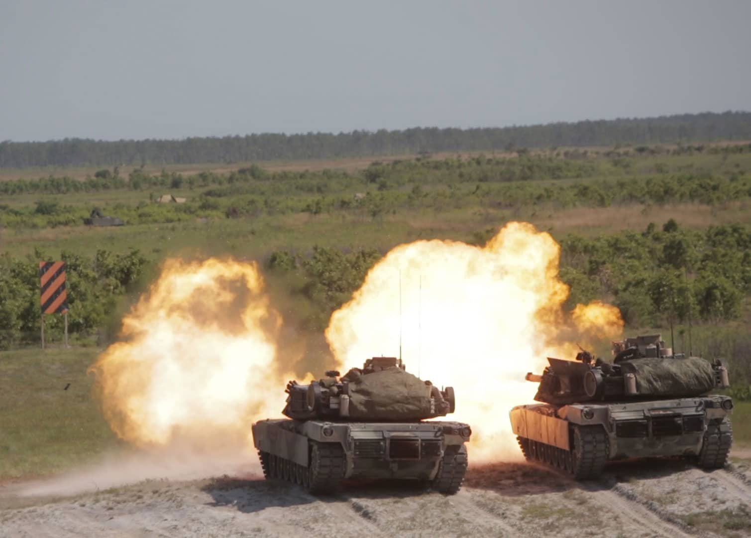 Marines deliver synchronized fire in their M1A1 Abrams tanks during a fire mission at Marine Corps Base Camp Lejeune, N.C., May 17, 2017. The Marines are participating in Burmese Chase, an annual, multi-lateral training exercise between U.S. armed forces and NATO members.