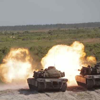 Marines deliver synchronized fire in their M1A1 Abrams Tanks
