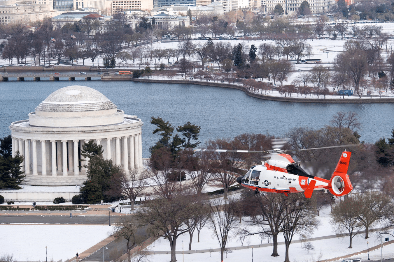U.S. Coast Guard Auxiliary member David Lau captured this image of a U.S. Coast Guard Air Station Atlantic City MH-65 Dolphin helicopter crew conducting patrols over Washington, D.C., last week. The aircrews support the National Capital Region Air Defense Facility (NCRADF) by supplying multiple aircraft to assist NORAD and USNORTHERN Command.