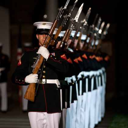 US Marines with the Silent Drill Platoon perform during an Evening Parade at Marine Barracks Washington in Washington, D.C. The Evening Parades were held every Friday night during the summer months.