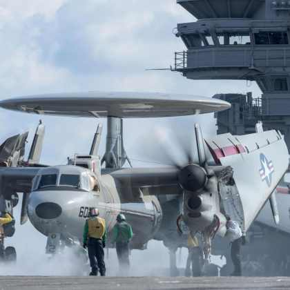 """WATERS SOUTH OF JAPAN (May 19, 2017) U.S. Sailors prepare to launch an E-2D Hawkeye assigned to the """"Tigertails"""" of Airborne Early Warning Squadron (VAW) 125 from the flight deck of the Navy's forward-deployed aircraft carrier, USS Ronald Reagan (CVN 76). Carrier Air Wing 5 is embarked on Ronald Reagan and conducting flight-deck qualifications to ensure the ship and air wing is able to safely launch and recover aircraft. Ronald Reagan, the flagship of Carrier Strike Group 5, provides a combat-ready force that protects and defends the collective maritime interests of its allies and partners in the Indo-Asia-Pacific region."""