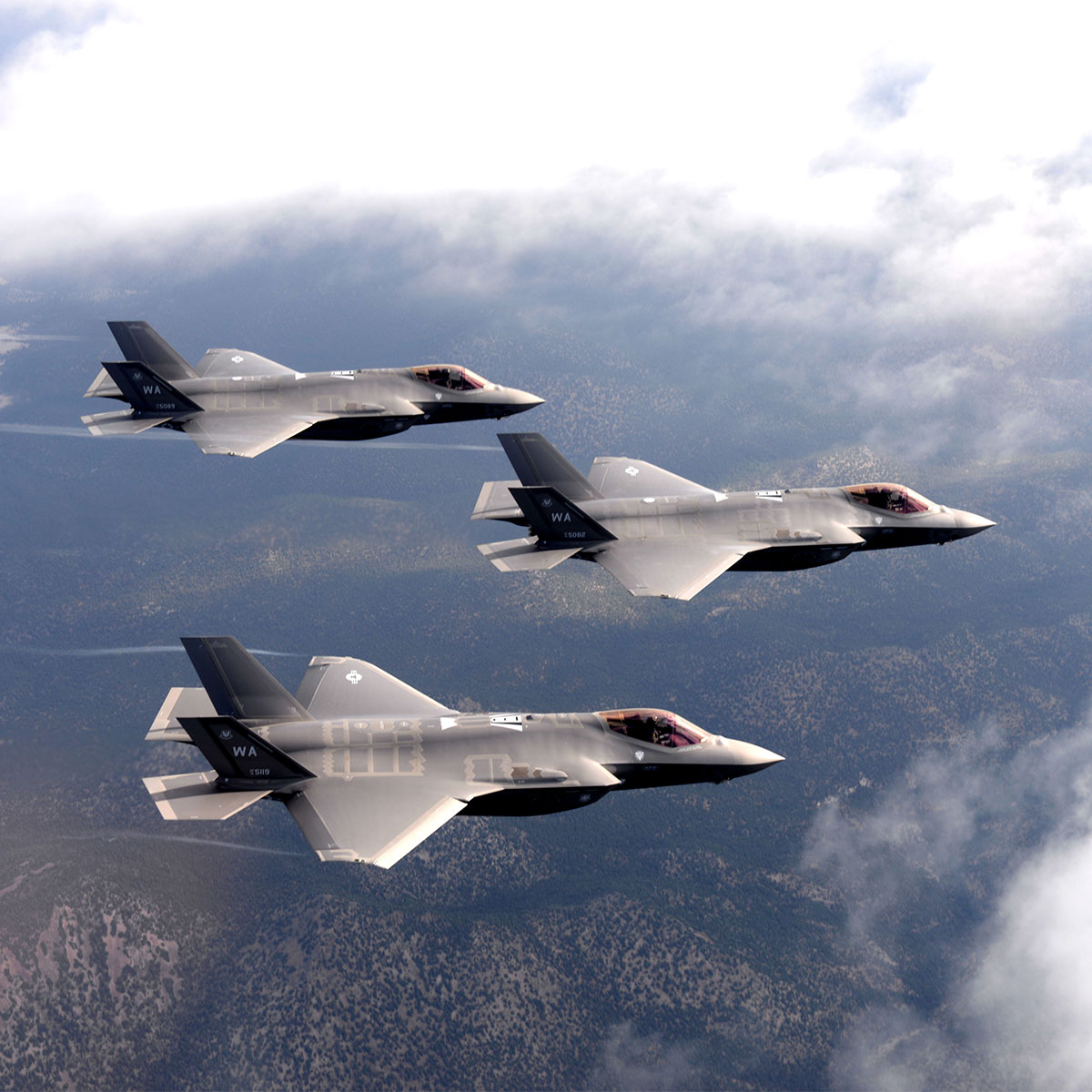 F-35 Lightning II, assigned to the 6th Weapons Squadron, at Nellis Air Force Base, Nevada, and F-22 Raptors fighter jets, assigned to the 433rd Weapons Squadron, at Nellis AFB, Nevada, fly in formation over the Nevada Test and Training Range.