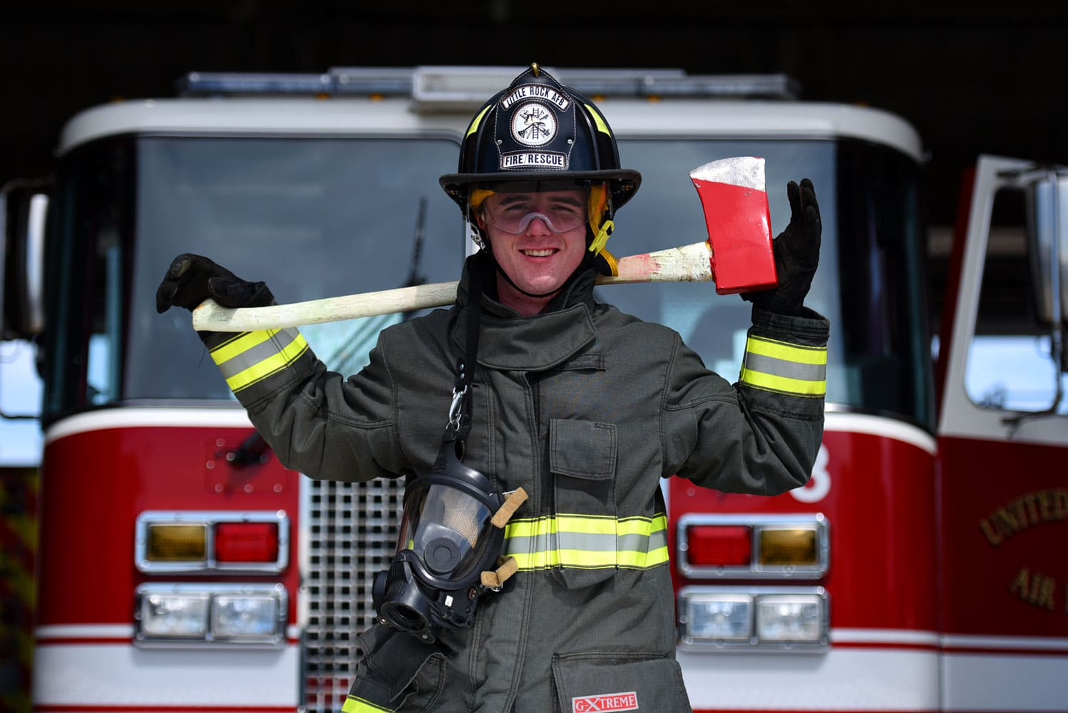 U.S. Air Force Airman 1st Class Zakary Smith, 19th Civil Engineer Squadron Fire Department firefighter, wields an axe at Little Rock Air Force Base, Ark. Firefighters must work together to perform their duties and keep the base populace safe during any emergency.