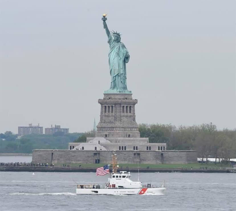 USCG Cutter Shrike, an 87-foot patrol boat based in Bayonne, New Jersey, passed by the Statue of Liberty as part of the Parade of Ships in New York's 29th Annual Fleet Week.