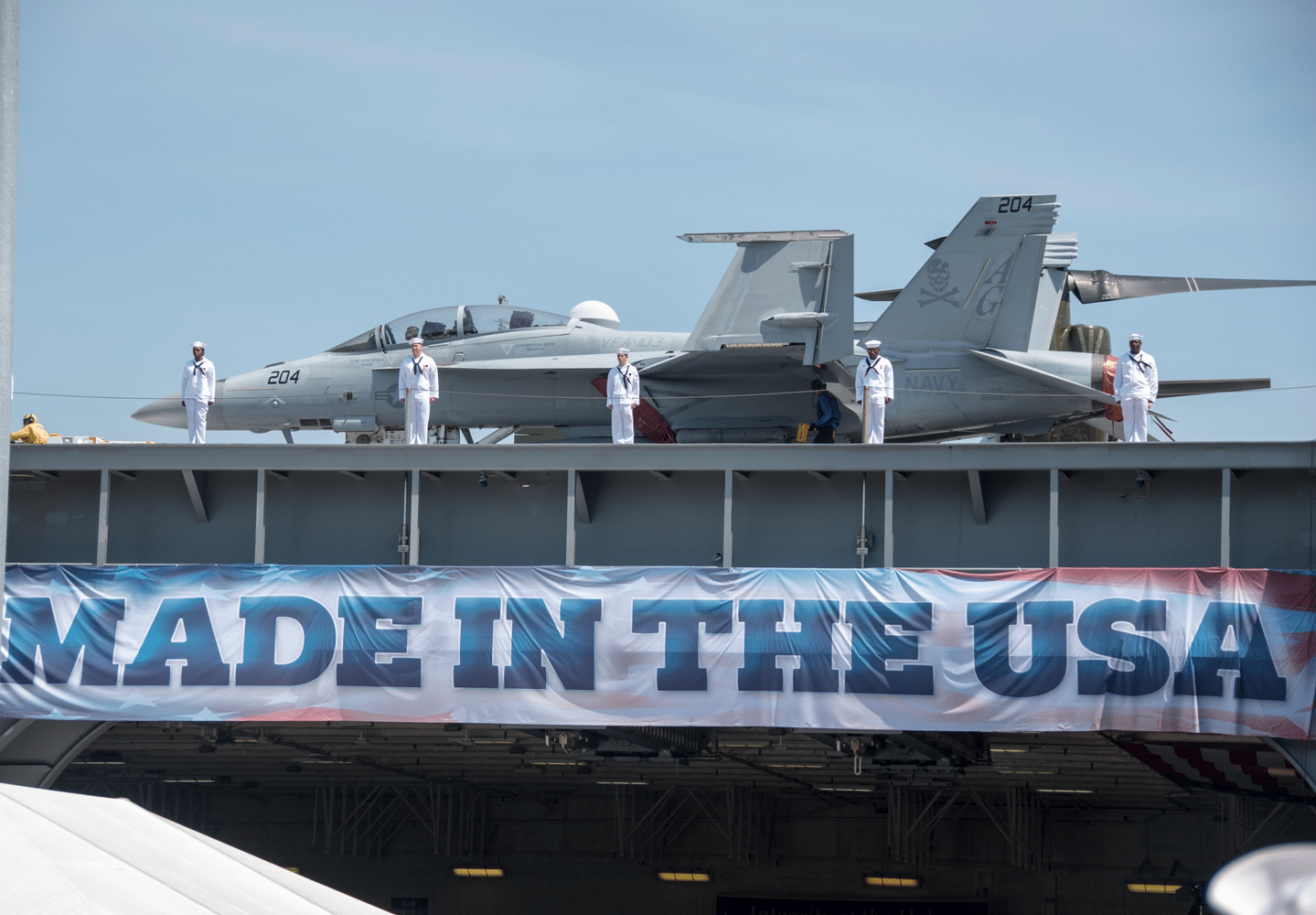 United States Navy Sailors man the rails of the aircraft carrier USS Gerald R. Ford during its commissioning ceremony at Naval Station Norfolk, VA. Ford is the lead ship of the Ford-class aircraft carriers, and the first new U.S. aircraft carrier designed in 40 years.