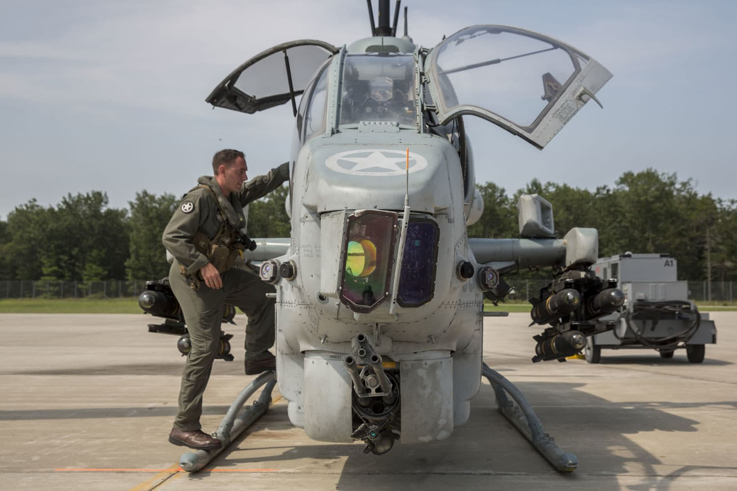 U.S. Marine Corps Maj. Paul D. Labalbo, an AH-1W Super Cobra pilot with Marine Light Attack Helicopter Squadron 269, inspects his aircraft during Northern Strike at the Combat Readiness Training Center Alpena, MI.
