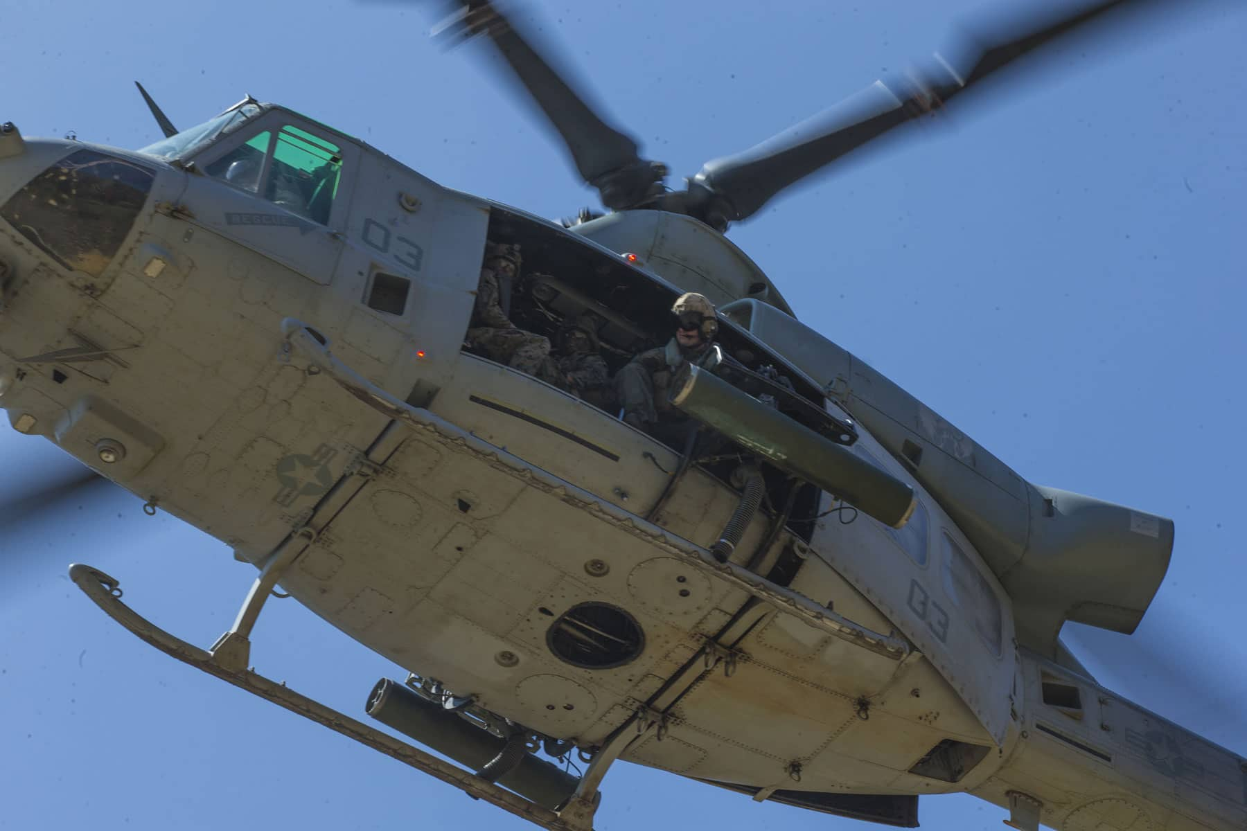 Marines with 1st Air Naval Gunfire Liaison Company (ANGLICO) prepare to rappel from a Bell UH-1 Iroquois on Camp Pendleton, California. 1st ANGLICO is conducting training to prepare Marines for future deployments.