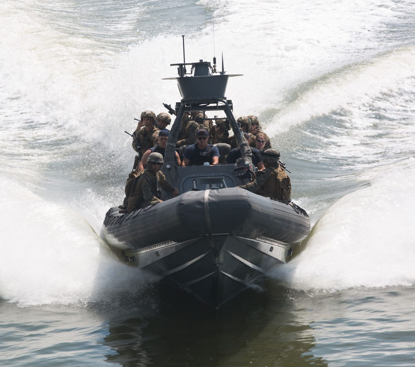 U.S. Marines with the Maritime Raid Force, 26th Marine Expeditionary Unit, utilize a rigid hull inflatable boat during visit, board, search and seizure training at Fort Eustis, VA.
